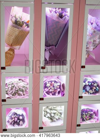 Close-up Of A Vending Machine With Bouquets Of Flowers For Sale. Sale Of Flowers In Vending Machines