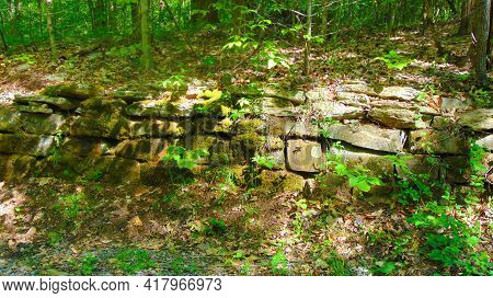 Old Mossy Stone Wall Found Within A Forest