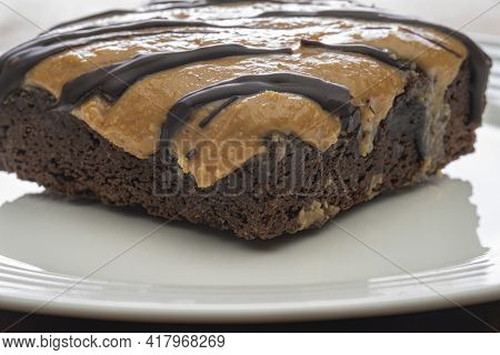 Dark Chocolate Drizzle Tops This Gluten Free Peanut Butter Chocolate Brownie.