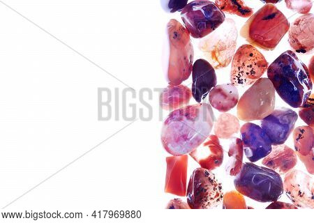South Onyx Heap Jewel Stones Texture On Half White Light Isolated Background. Place For Text.