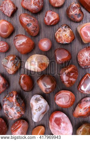 South Onyx Rare Jewel Stones Texture On Brown Varnished Wood Background