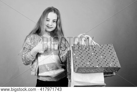 Presenting Product. Happy Child. Little Girl With Gifts. Small Girl With Shopping Bags. Sales And Di
