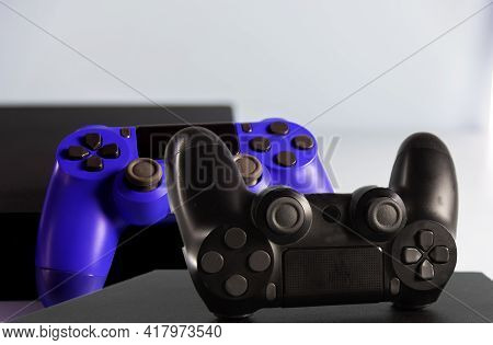Controls And Video Game Console On Light Background