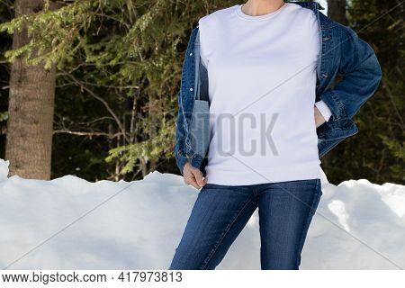 White Sweatshirt Mockup Of A Girl  In Snowy Winter Forest, Model Mockup