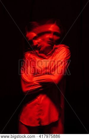Portrait Of A Psychotic Woman With Mental Disorders And Bipolar Disease In A White Straitjacket