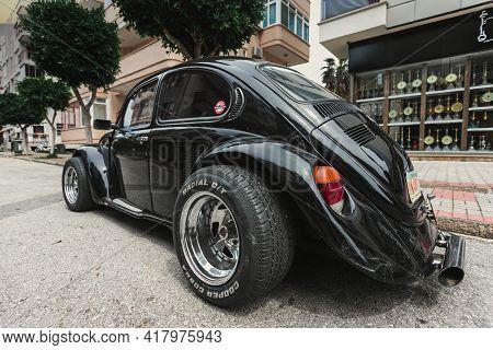 Alanya, Turkey - April 12 2021:    Vintage Black Car Volkswagen Beetle, Side  View. Photography Of A