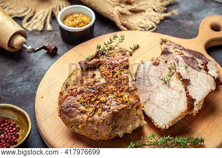 Oven Roasted Pork Loin. Large Piece Of Baked Pork With Mustard On A Cutting Board. Food Recipe Backg