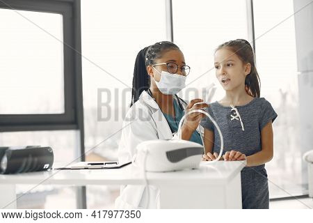 Doctor Makes A Procedure For A Little Girl