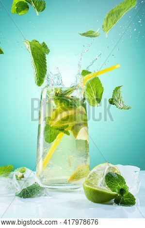 Mojito With Mint And Ice. Flying Spray And Mint. A Vivid Photograph Of A Refreshing Drink. Vertical