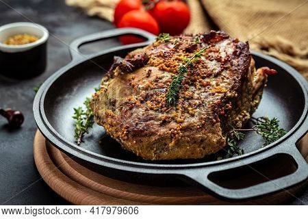 Roasted Pork Loin. Large Piece Of Baked Pork With Mustard On Pan. Festival Food Recipe Background. C