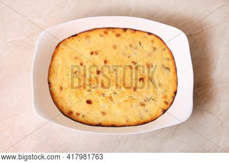 Cottage Cheese Casserole In A Baking Dish On Marble Background.