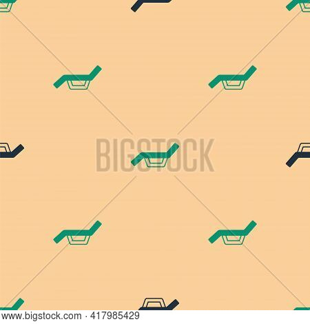 Green And Black Sunbed Icon Isolated Seamless Pattern On Beige Background. Sun Lounger. Vector