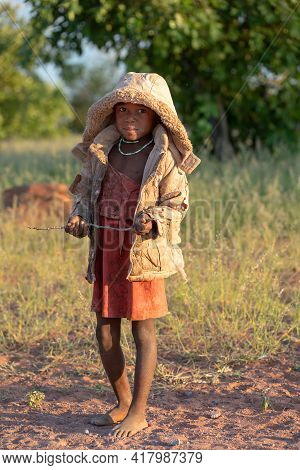 Namibia, Omusati Region, May 7: African Girl In Early Cold Morning On The Road To City Opuwo. Northe