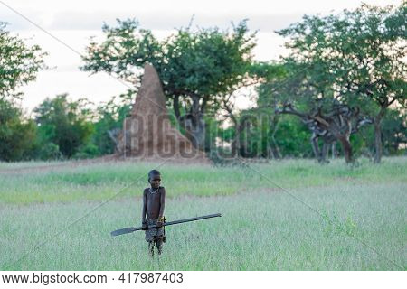 Namibia, Omusati Region, May 7: The Himba Boy In Early Cold Morning In Grassland. The Himba Are Afri