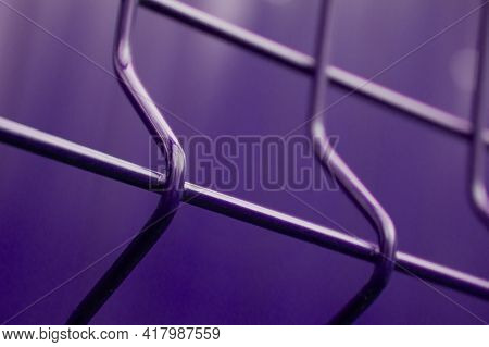 Background Abstraction Curved Metal Bars In Neon Light. Table Site Curved Fence Rods In Follet Tonal