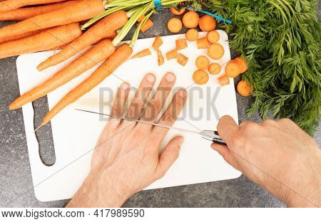Cutting Fingers With A Knife - Concept Of Clumsiness