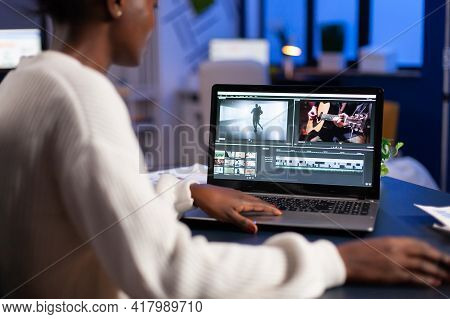 Black Video Editor Working Overtime At New Project Editing Audio Film