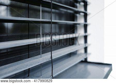 A Closeup Of A Window With External Aluminum Venetian Blinds.