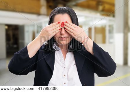Corporate Businesswoman Or Entrepreneur Covering Eyes With Palms As Secret Concept Wearing Office Sm
