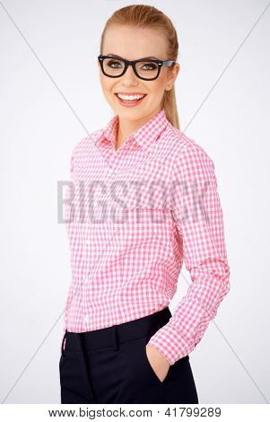 Portrait of a happy blonde geek girl wearing pink shirt and smart glasses