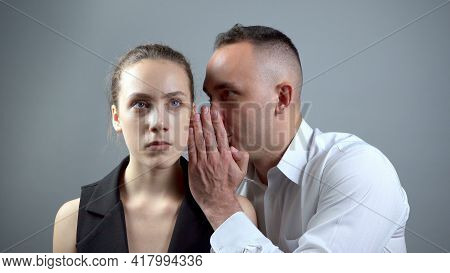 Shooting Of Two Gossipers On Grey Background