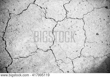 Concrete With Crack Background. Old Broken Cement Floor Wall. Chapped Stone Asphalt Surface Texture