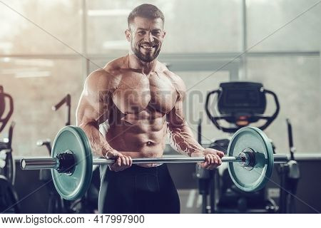 Brutal Strong Athletic Men Pumping Up Muscles Workout Bodybuilding Concept Background - Muscular Bod