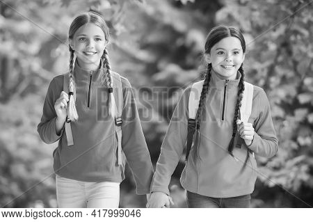Girls Backpackers Friends Fleece Clothes Backpacks Forest Background, Family Hike Concept