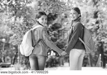 Adventure Awaits Go Find It. Happy Children Travel Natural Outdoors. Little Girls Wear Backpacks. Pl