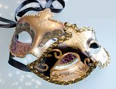 Two Venetian masks with shining glow of stars poster