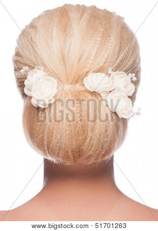 Portrait of young beautiful woman with elegant hairstyle, over white background. Rear view