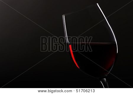 Wineglass With Redwine Before Black Background