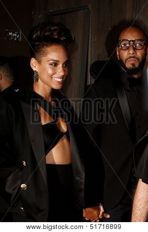 NEW YORK-SEP 28: Singer Alicia Keys (l) and husband Swizz Beatz attend the grand opening of TAO Downtown at the Maritime Hotel on September 28, 2013 in New York City.