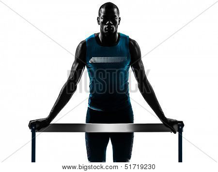 one african man hurdler runner standing in silhouette studio isolated on white background