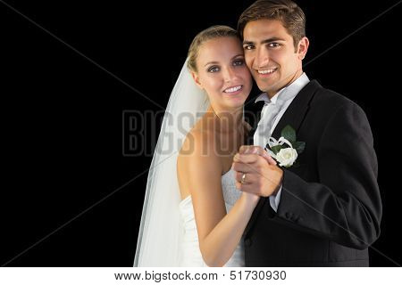Smiling married couple dancing viennese waltz smiling at camera