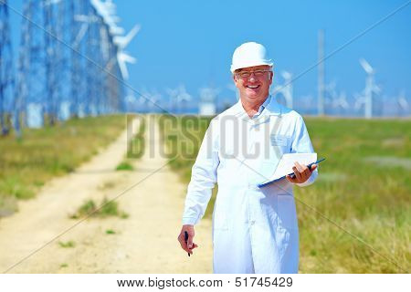 researcher analyzes readouts on wind power station poster