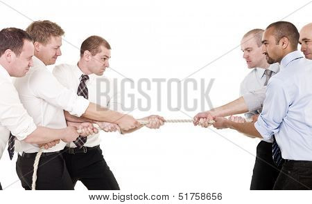 Businessmen in a tug-of-war isolated on white background