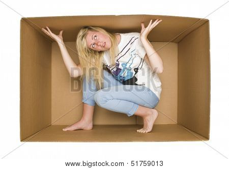 Young Woman inside a Cardboard Box isolated on white Background
