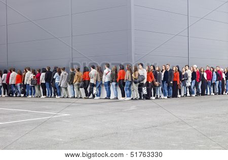 Large group of people waiting in line