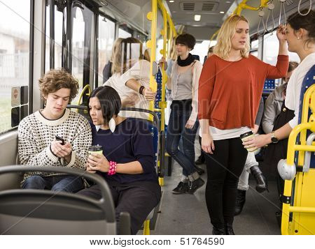 Couple going by bus with large group of people
