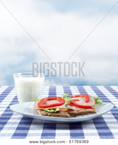 Breakfast with bread and milk on a table