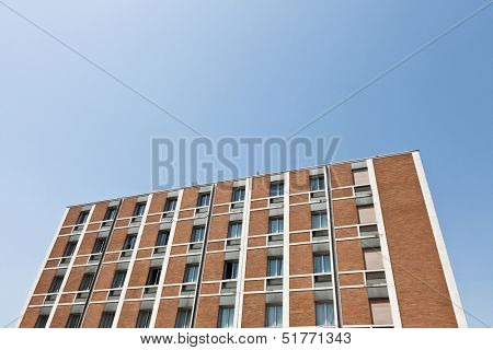 Brick Wall building towards blue sky
