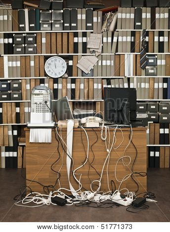Overloaded desk at a messy office