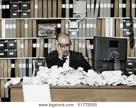 Tired Businessman at a messy office