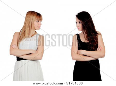 Angry teen sisters isolated on a white background