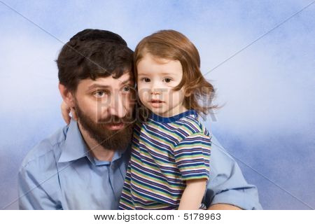 Jewish Father In Yarmulke Hugging With His Young Son