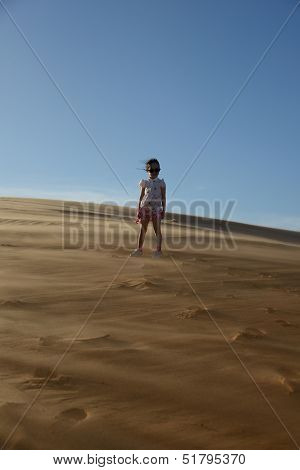 Young girl standing in the desert