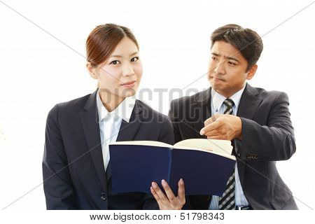 Stressed businessman and businesswoman