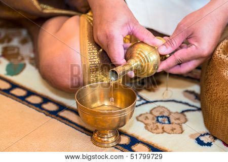 Buddhist s grail pouring water