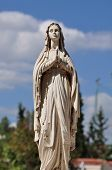 Virgin Mary hands joined in prayer marble funerary statue. poster